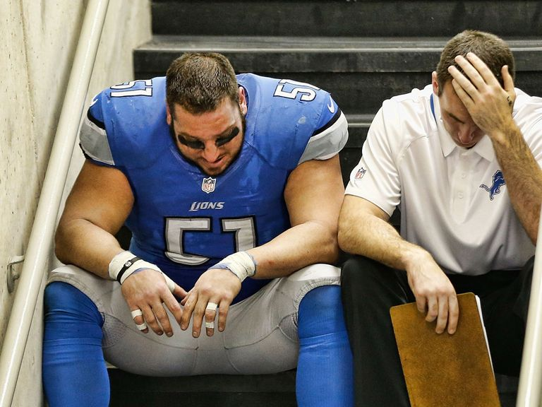 A dejected Dominic Raiola after Detroit's elimination