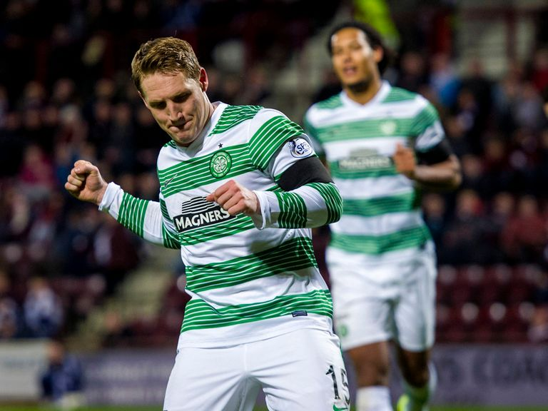 Kris Commons netted a hat-trick as Celtic beat Hearts 7-0.