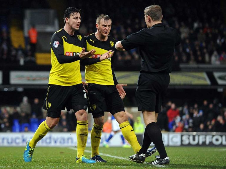 Furious Watford players protest to Graham Scott at Portman Road