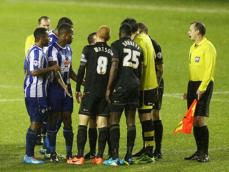 Sheffield Wednesday and Wigan players shake hands