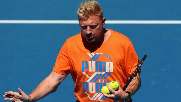 Boris Becker on court in Melbourne helping Novak Djokovic