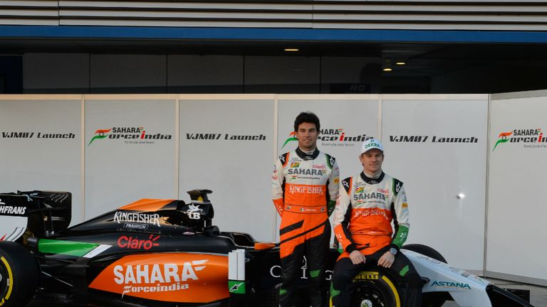 Force India: Sergio Perez and Nico Hulkenberg pose with the VJM07