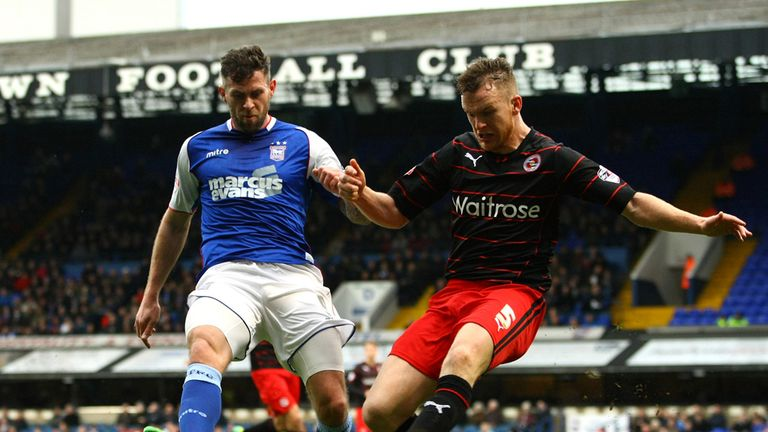 Daryl Murphy (left) and Alex Pearce: Battle for the ball at Portman Road