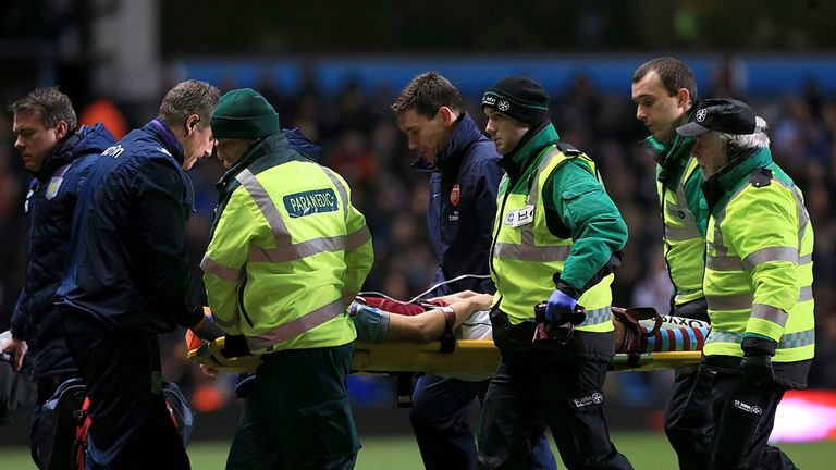 Nathan Baker: Aston Villa defender is carried off on Monday