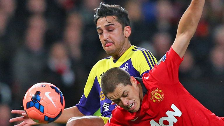 Neil Taylor: In action against Manchester United's Javier Hernandez
