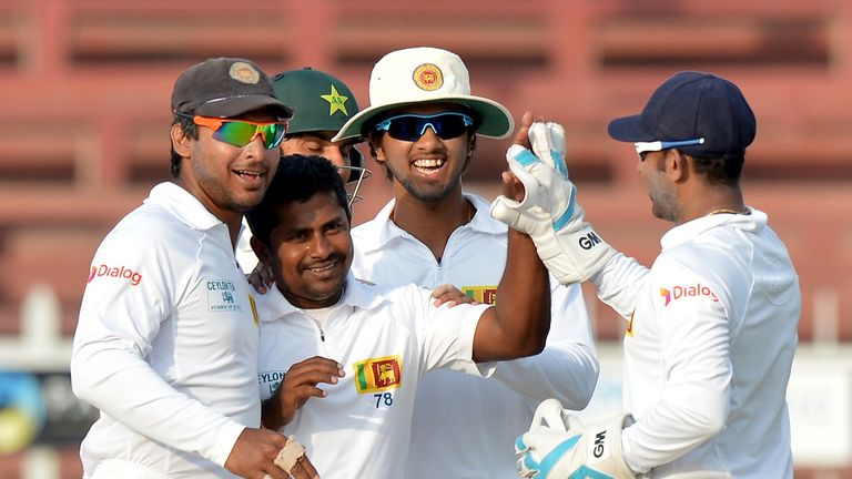 It is all smiles for Sri Lanka as three late wickets give them the edge against Pakistan