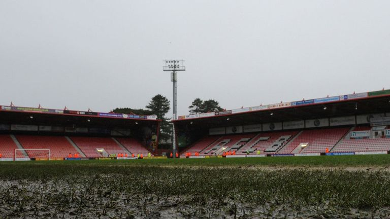 The waterlogged pitch at the Goldsands Stadium