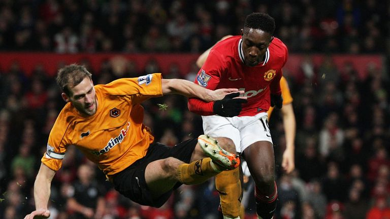 Rogers Johnson tackles Manchester United's Danny Welbeck