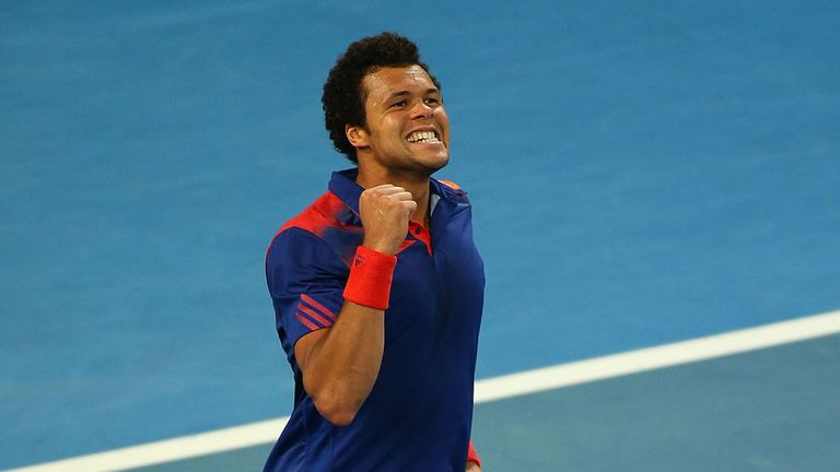 Jo-Wilfried Tsonga celebrates victory in the singles