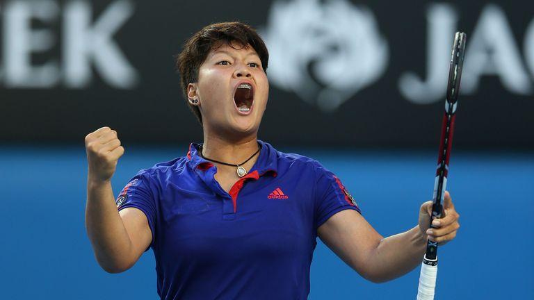 Luksika Kumkhum celebrates beating Petra Kvitova