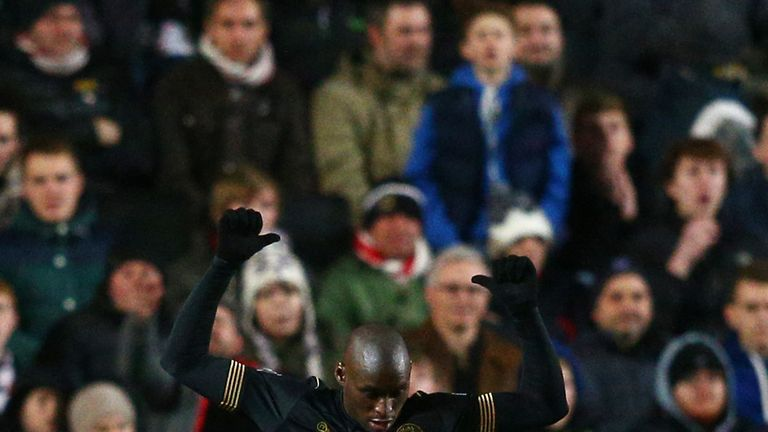 Marc-Antoine Fortune celebrates after scoring Wigan's third against MK Dons