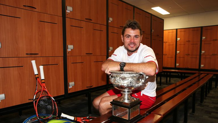 Stanislas Wawrinka: Swiss poses with the Australian Open trophy in the locker room at Melbourne Park