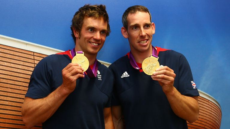 Tim Baillie and Etienne Stott pose with their Olympic gold medals