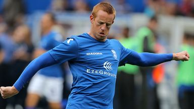 Adam Rooney: Aberdeen have signed striker following Oldham exit