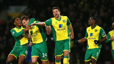 Ryan Bennett (centre): Mobbed after heading Norwich to victory over Hull