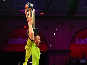 Michael van Gerwen lifts his prize.