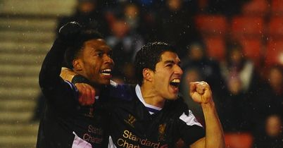 Daniel Sturridge: Celebrates goal at Stoke with Luis Suarez
