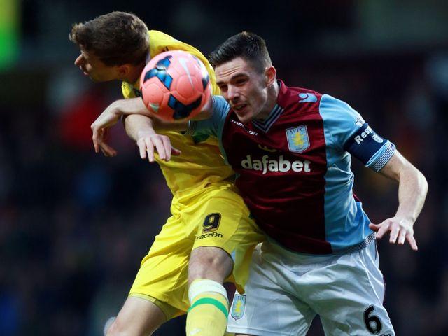 Aston Villa's Ciaran Clark wins a header
