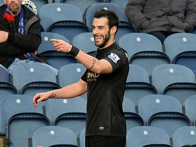 Alvaro Negredo celebrates his opener for City