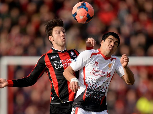 Harry Arter and Luis Suarez battle for the ball