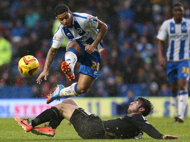Liam Bridcutt is halted by Harry Arter