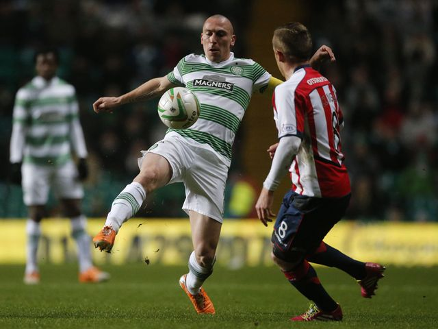 Scott Brown and Sammy Clingan battle for the ball