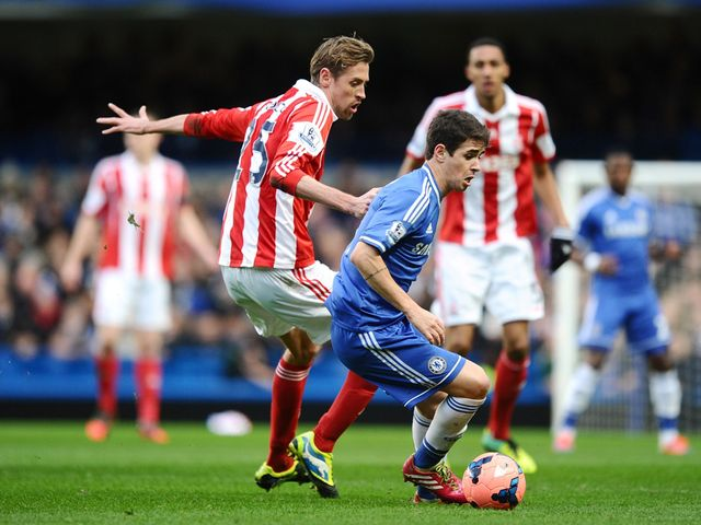 Oscar turns away from Peter Crouch