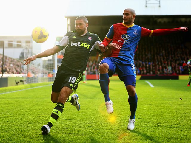 Jonathan Walters is put under pressure by Adlene Guedioura