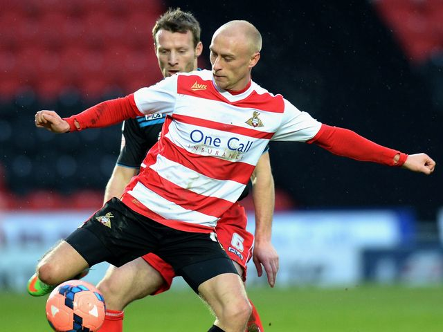 David Cotterill (right) of Doncaster Rovers is challenged