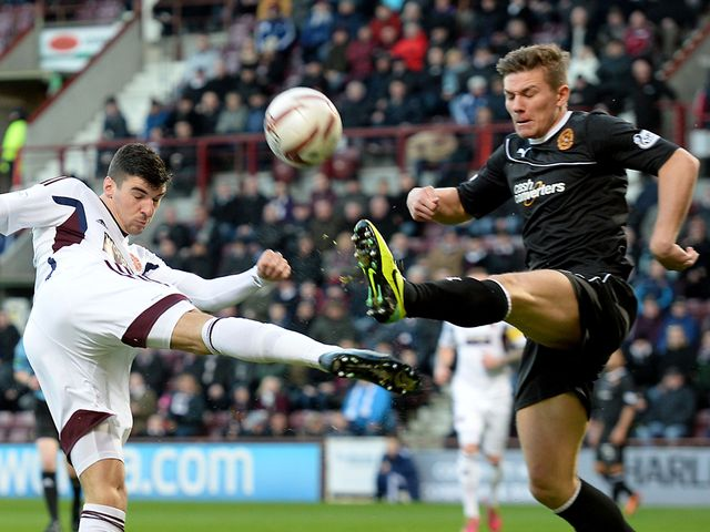 Callum Paterson battles for the ball with Shaun Hutchinson