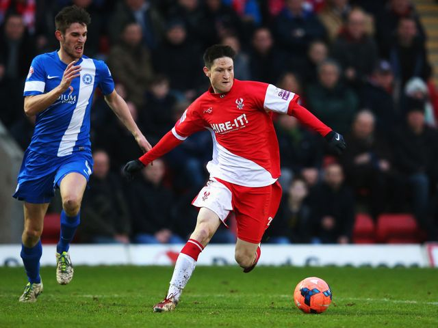 Joe Lolley of Kidderminster Harriers in possession