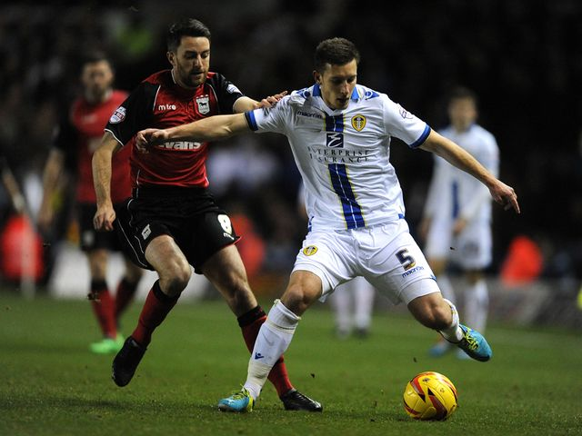 Cole Skuse and Jason Pearce battle for the ball