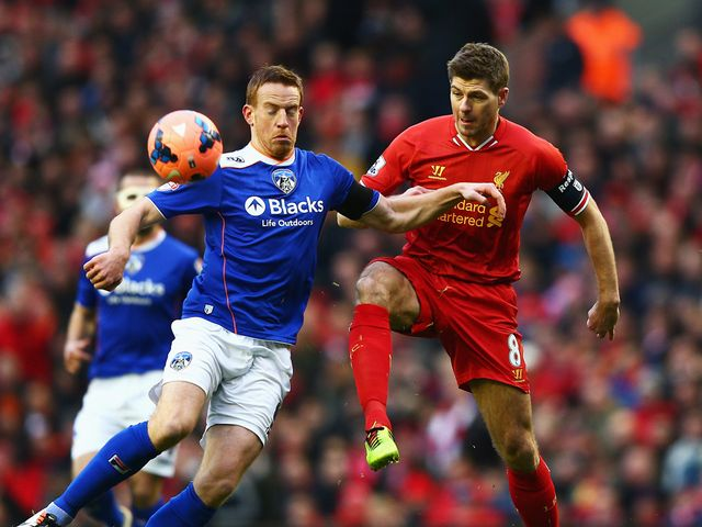 Steven Gerrard challenges Adam Rooney