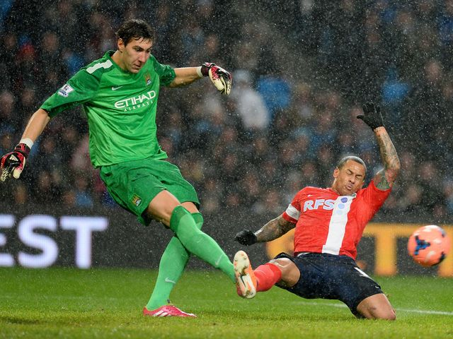 Costel Pantilimon kicks the ball away from DJ Campbell