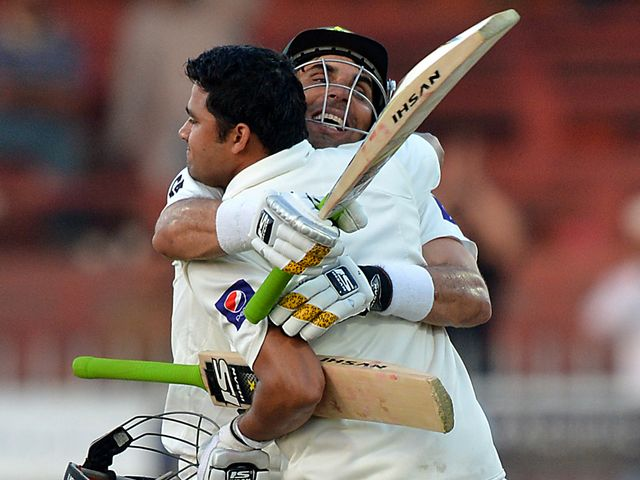 Misbah congratulates Azhar Ali on his century.