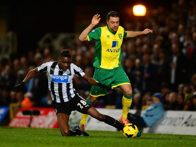 Sammy Ameobi tries to tackle Russell Martin