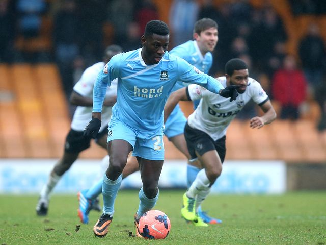 Temitope Obadeyi of Plymouth Argyle controls the ball