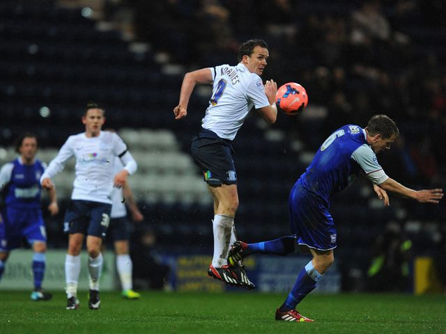 Kevin Davies looks on after winning a header