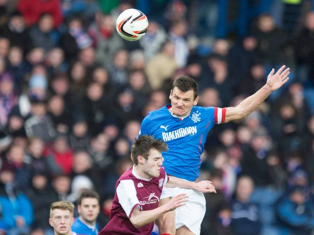 Lee McCulloch jumps high for a header