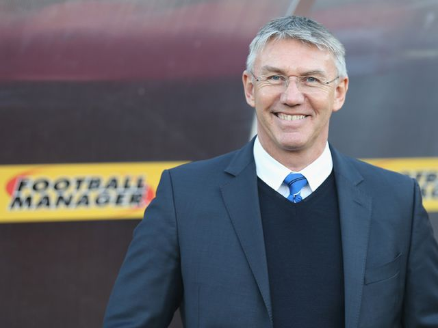 Nigel Adkins is all smiles at Watford.