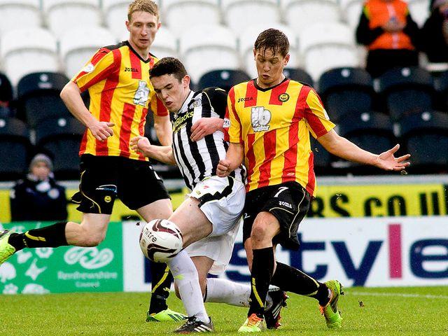 John McGinn challenges James Craigen