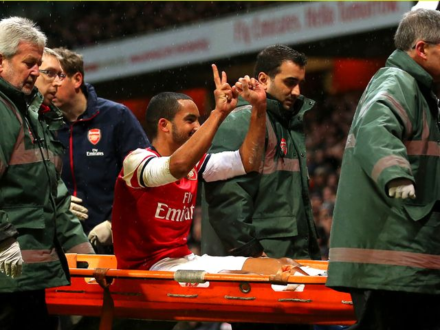 Theo Walcott gestures towards the Tottenham fans