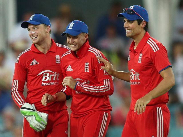 Jos Buttler celebrates with Root and Cook