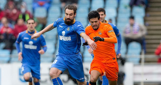 Borja and Carlos Vela battle for the ball