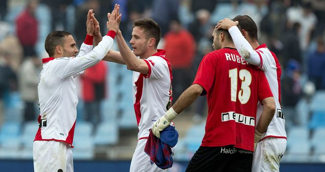 Real Vallecano players celebrate after completing victory