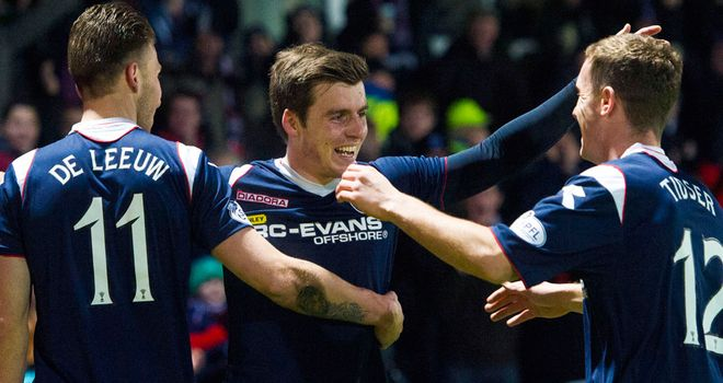 Graham Carey celebrates after bagging a late winner