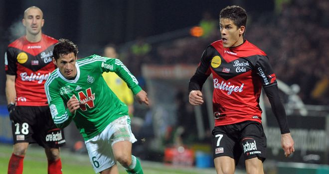 Guingamp's Dorian Leveque vies with Jeremy Clement