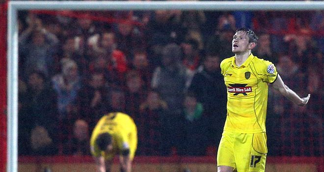 Burton goalscorer Jimmy Phillips dejected after conceding one of four Bournemouth goals