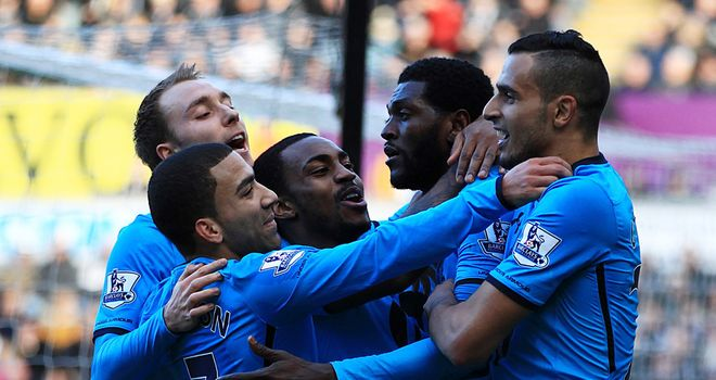 Emmanuel Adebayor: Mobbed by his team-mates after netting the opener