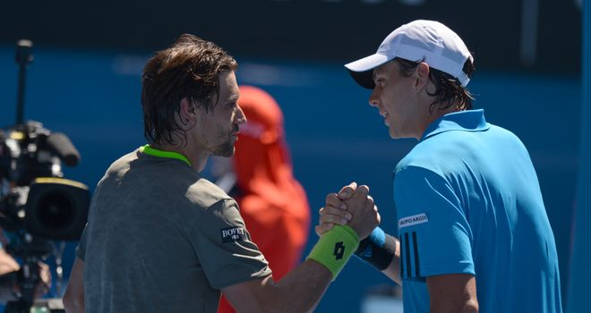 David Ferrer (left) shakes hands with Alejandro Gonzalez